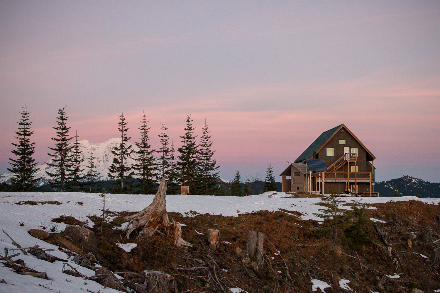 Bruni's Snow Bowl Hut and Mt. Rainer in the distance.
