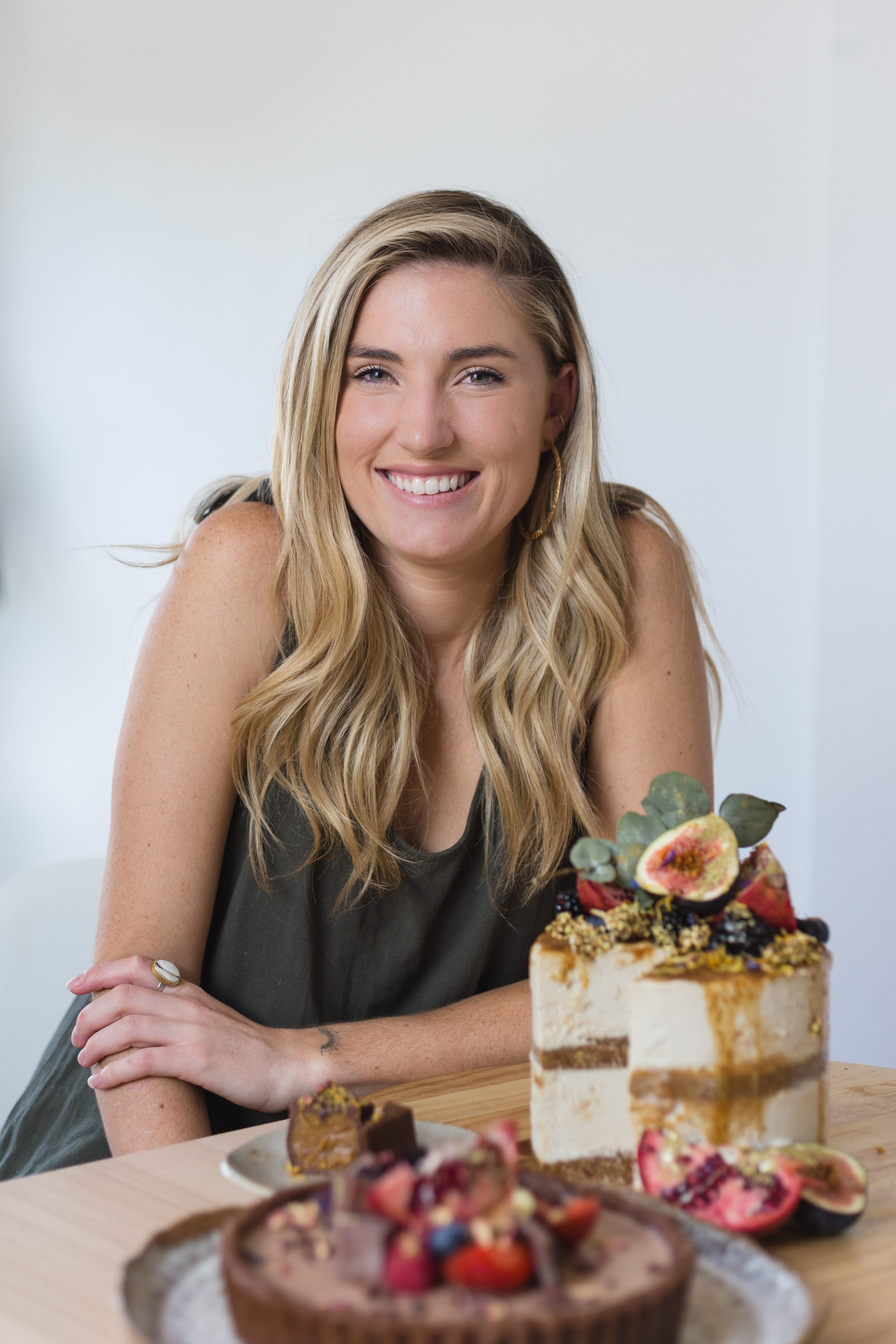 """The Kindness Echoes / Organic+ Vegan Desserts - Georgia Irwin has always been a creator, but after watching a pro-vegan documentary, she found a new art form in creating vegan treats that do good by our bodies and the environment.Here, she talks about her mission for spreading kindness, how she's healed through building a business, and why you don't need to follow the """"quit your job and go for it"""" type advice."""