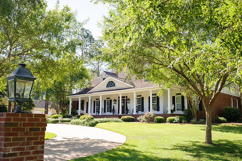 ALDRIDGE  This grand home, originally built in 1999, represents the idea of a true forever family home. From the picturesque landscaped yard to the newly renovated outdoor cookhouse to the redesigned attic space, everything about this home signifies elegance mixed with the comforts and demands of the life of a busy, growing family. The exceptional balance between formal and personal touches can be seen throughout the welcoming home of Dr. and Mrs. Aric Aldridge.