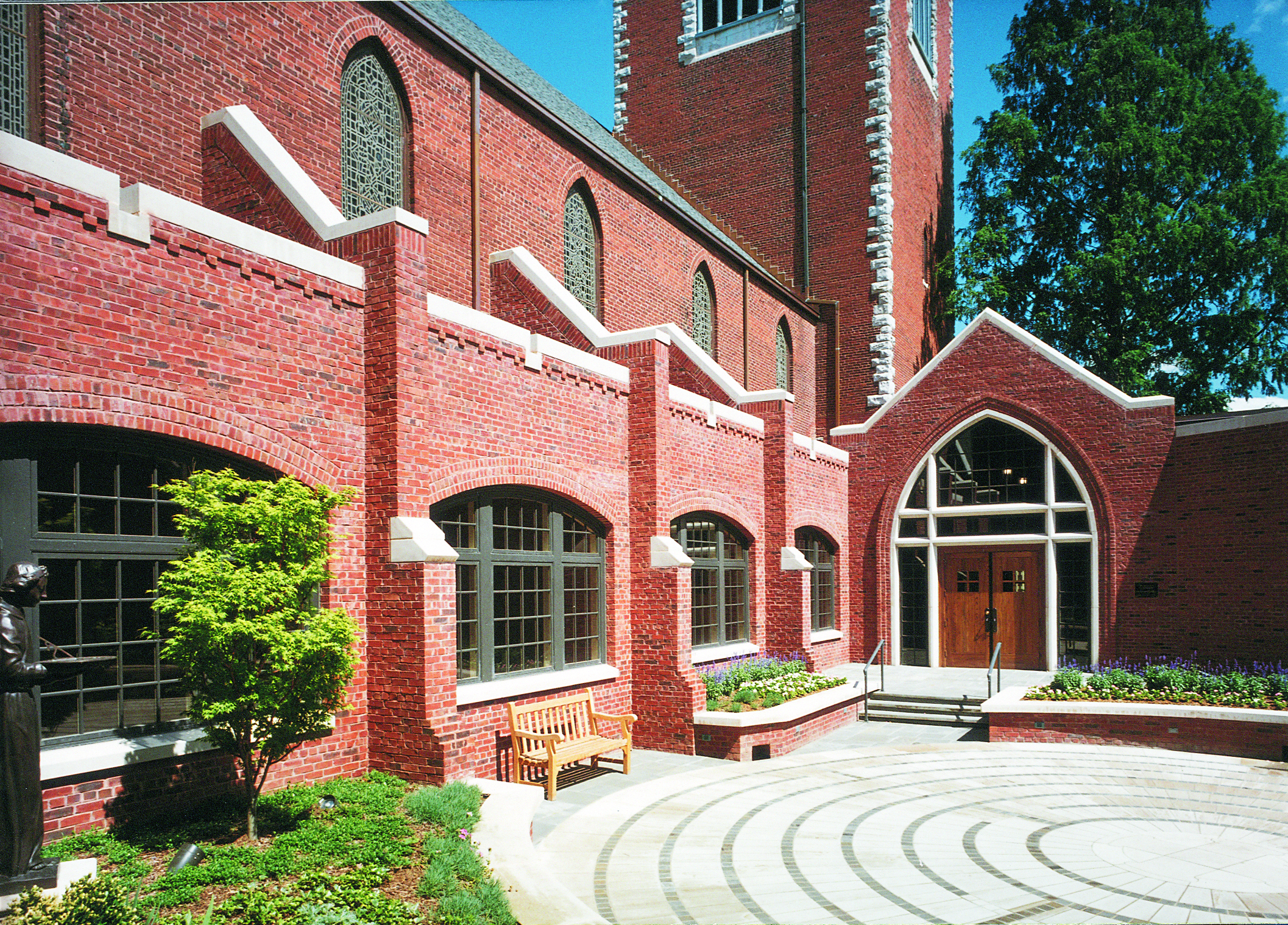 """St Paul's Episcopal Church   We designed this traditional masonry addition to this downtown Church, to provide new offices, Sunday school classrooms, and address the importance of the """"everday"""" building entrance. The new program spaces are organized around an interior courtyard which provides overflow capacity to the narthex and buidling code separation to the National Historic Registered Church. The buidling received an Excellence in Masonry from the Tennessee Masonry Institute in 2001."""