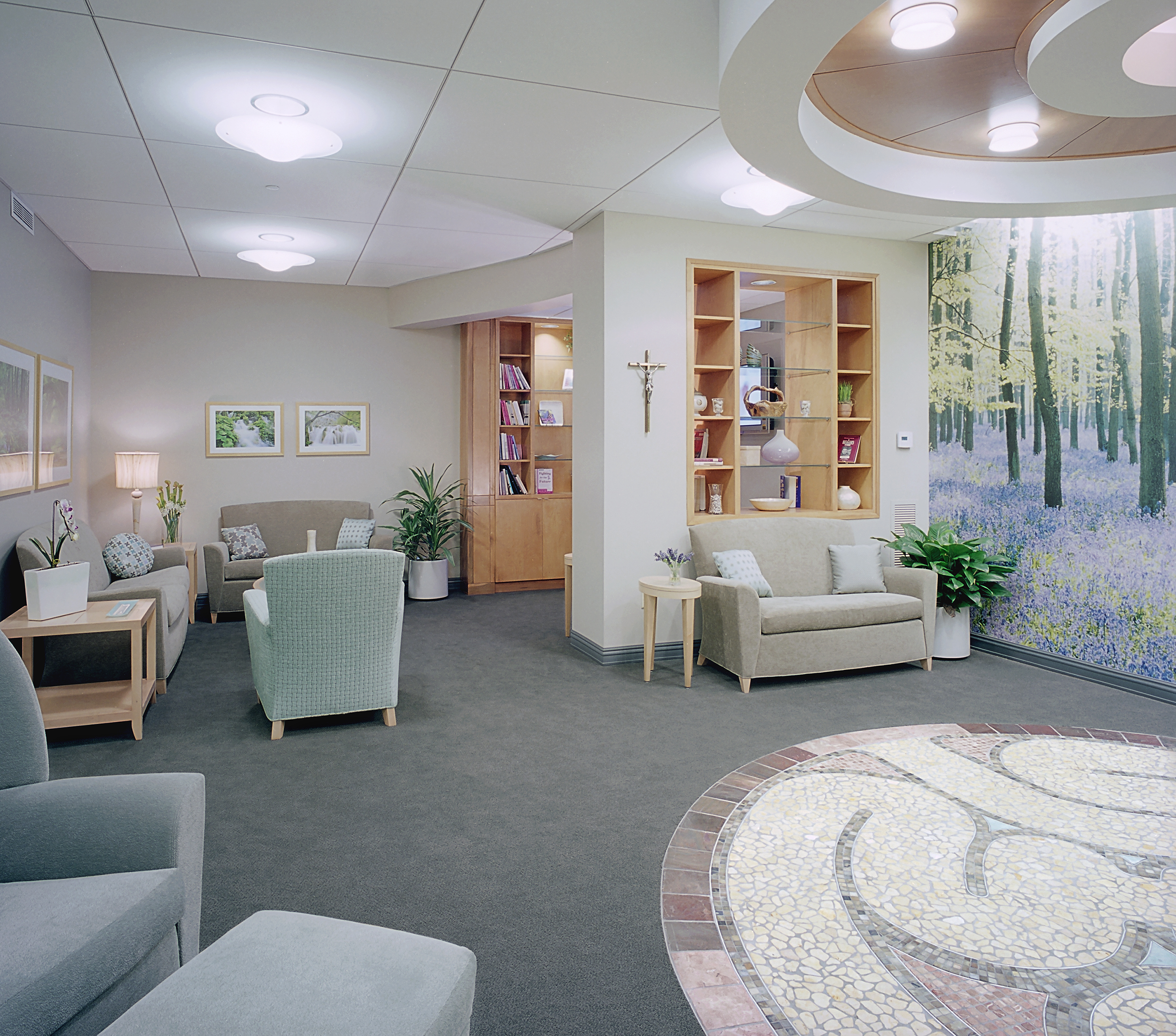 Memorial Hospital -  Mary Ellen Locher Breast Center   The project consisted of a full renovation of the former office area in Memorial Hospital's Physician's Building, Chattanooga, TN. The Breast Center's purpose is to provide services and accommodate patients at all stages of cancer treatment. The client desired the space to project an atmosphere that was calming, light, and feminine. Serpentine shapes, pale colors, and natural features provide a welcoming and soothing environment for patients and staff. The project included a full Infusion Center, mammography rooms, ultrasound rooms, MRI, and other various procedure rooms, multiple patient waiting areas, and a small boutique for cancer friendly accessories.