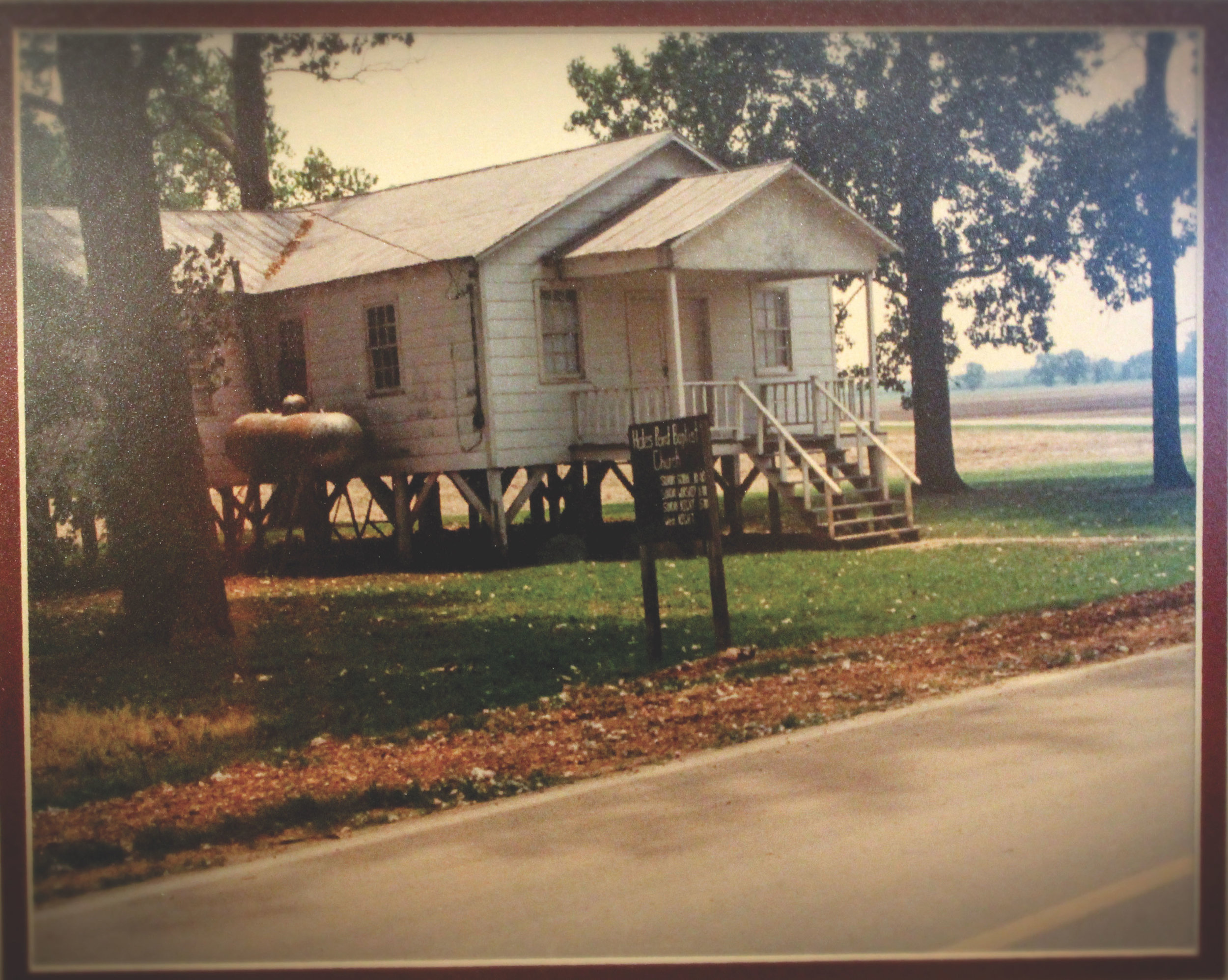 A shot of the original Hales Point Baptist church standing on stilts, later to be crafted into the Just Divine Tea Roo.