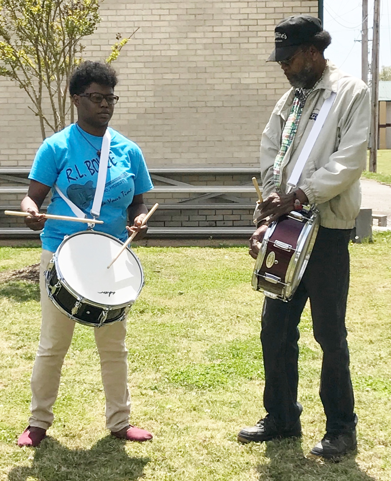 Grammy-nominated Bluesman RL Boyce teaches student Kesha Burton the fife and drum traditions during a recent lesson at the Delta Heritage Center in Brownsville. Boyce and Burton are a part of the Tennessee Arts Commission Apprenticeship Program that pairs a master with a student in an effort to pass on knowledge of traditional art forms to a new generation.