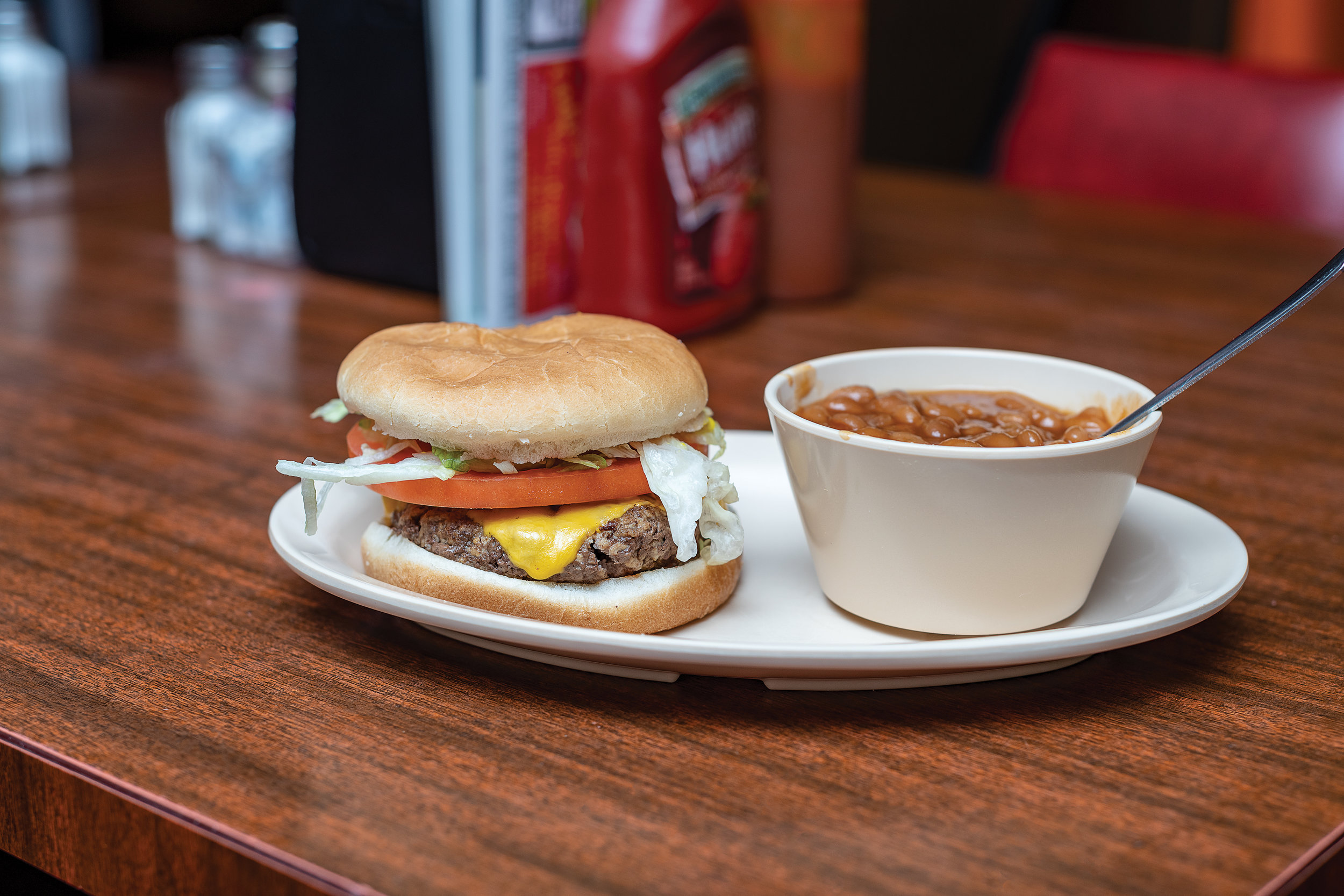 Single cheeseburger with baked beans