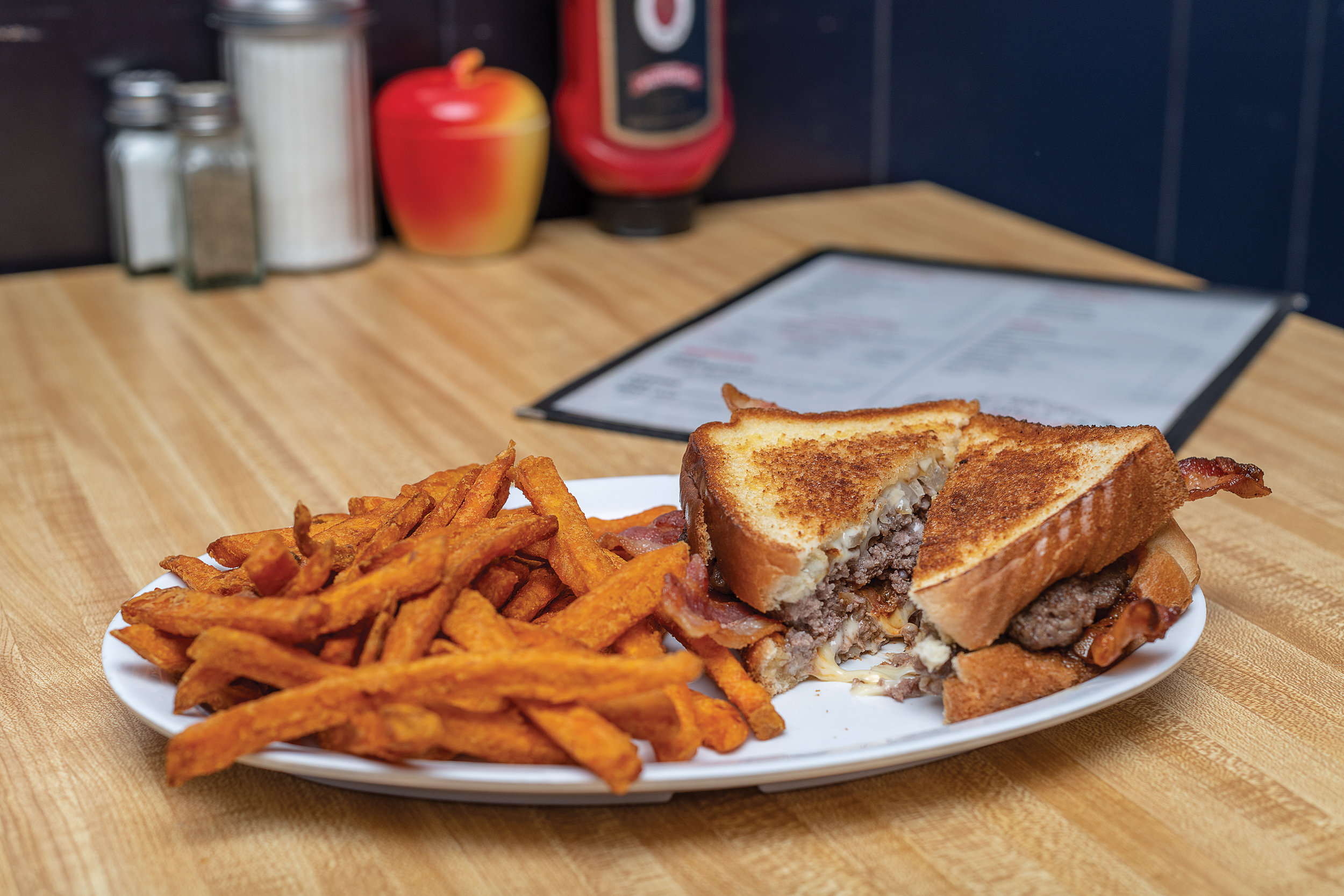 Patty melt with chipotle sauce and bacon with sweet potato fries