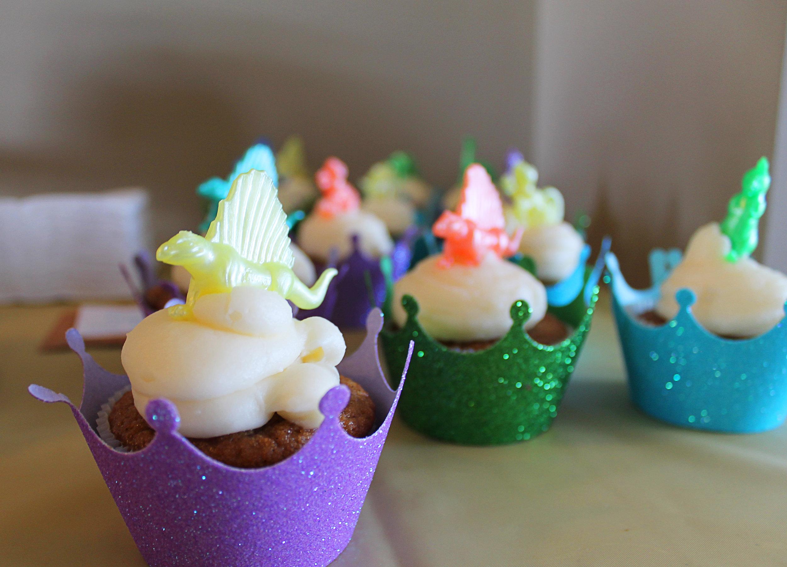 Cupcake  wrappers . Pearlized  dinosaurs . Gold  dinosaurs . Dinosaur  sprinkles .