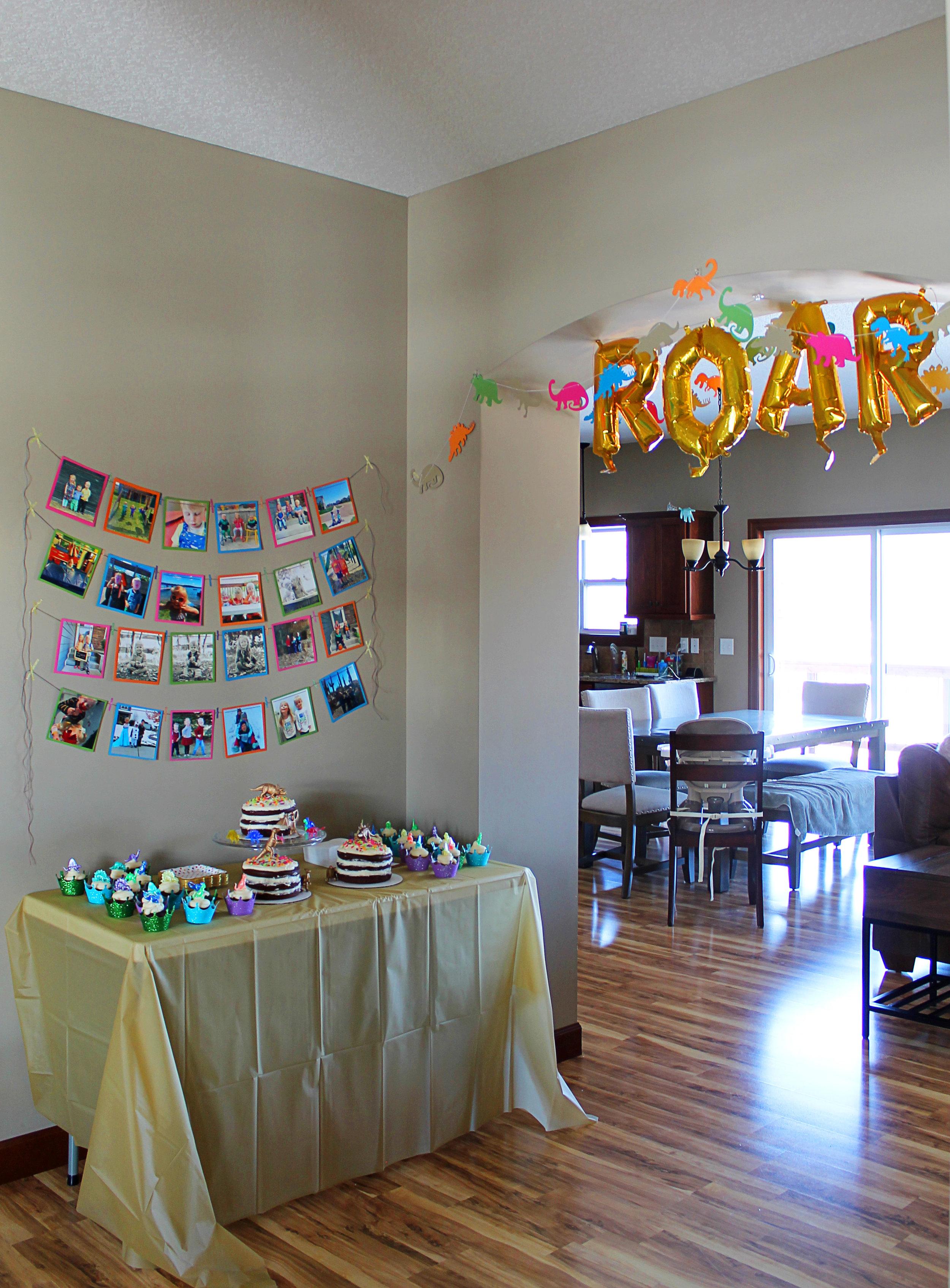 Dinosaur  banners . Gold  balloons .