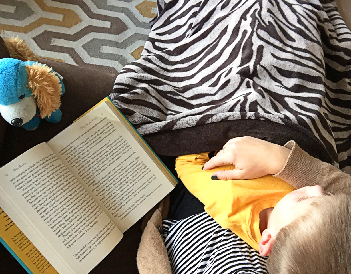 How I've been keeping up on reading lately: surrounded by small children, blankets, and stuffed animals during our afternoon screen time break.
