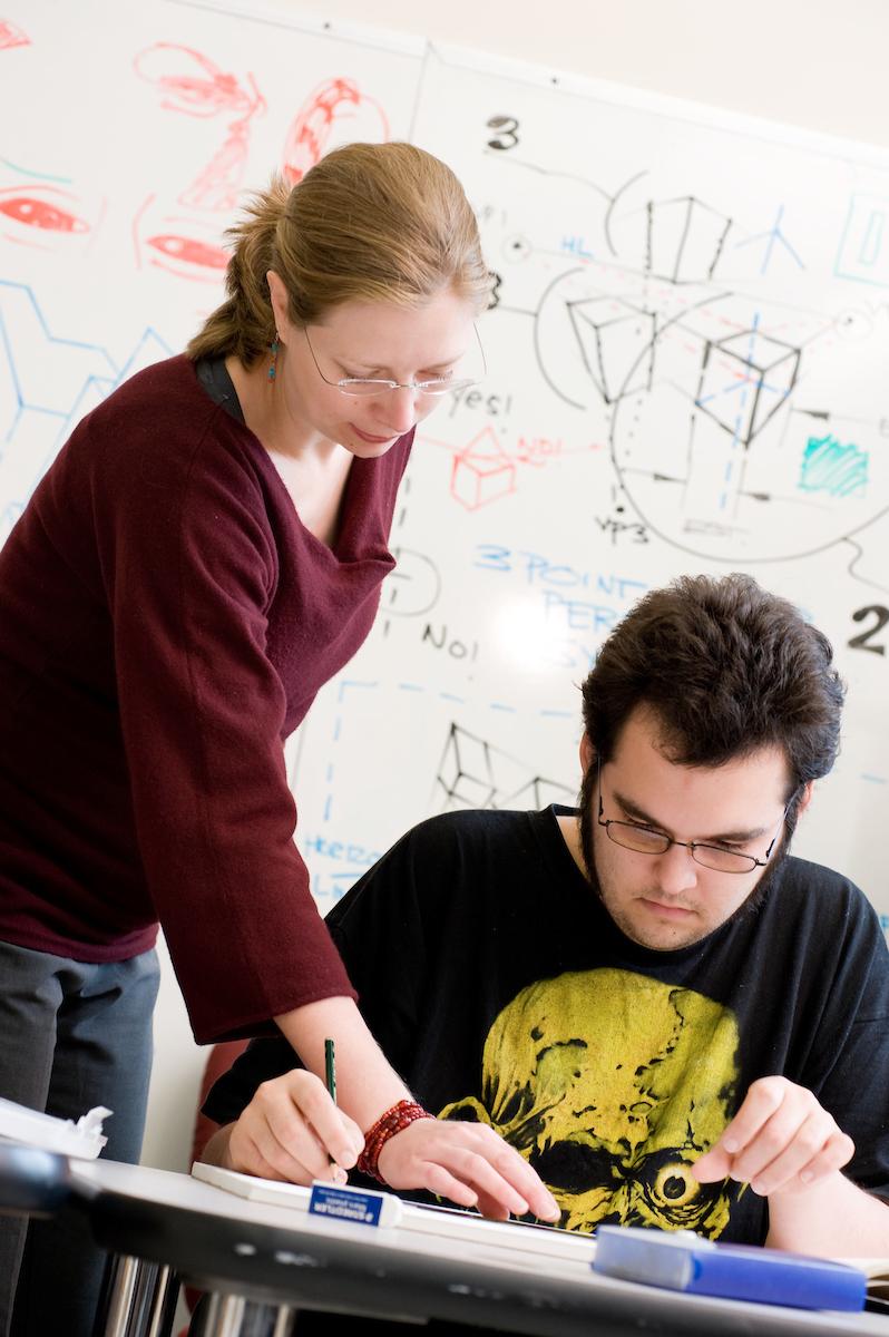 JWU tutor helps student with homework