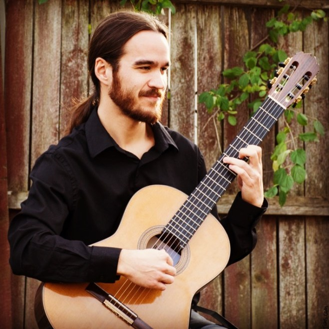 Steve Yim, Suzuki-trained classical guitarist, who donated his time to make the evening a success