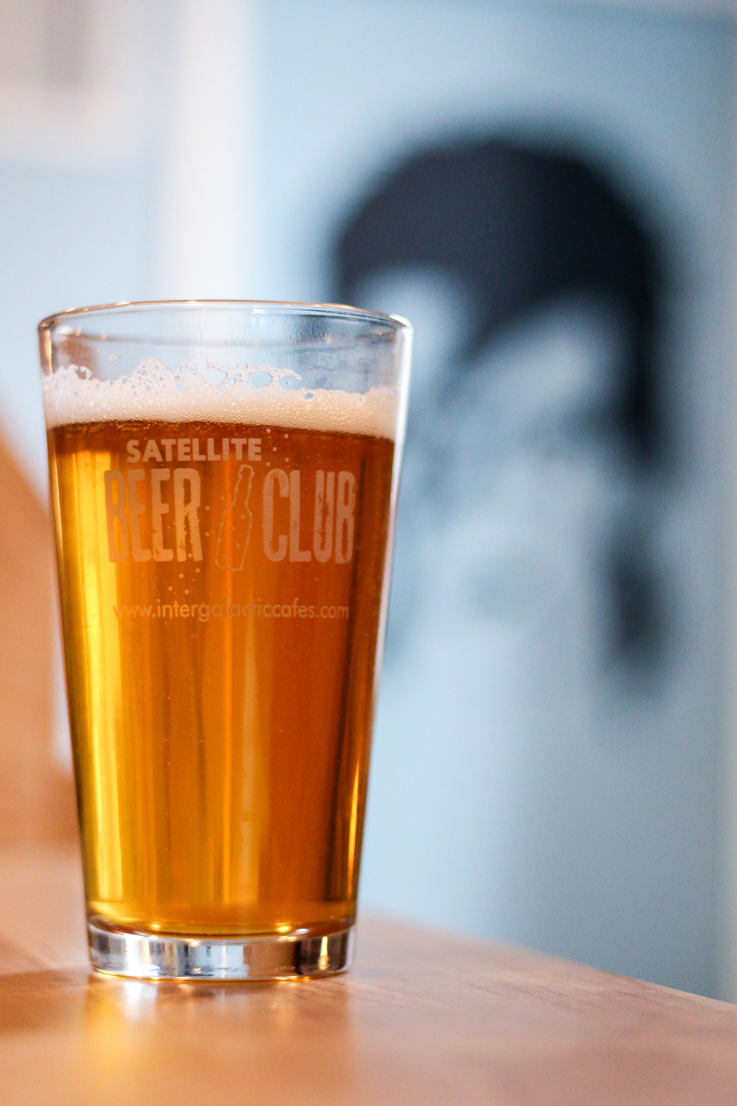 Beer in Satellite Beer Club glass on counter