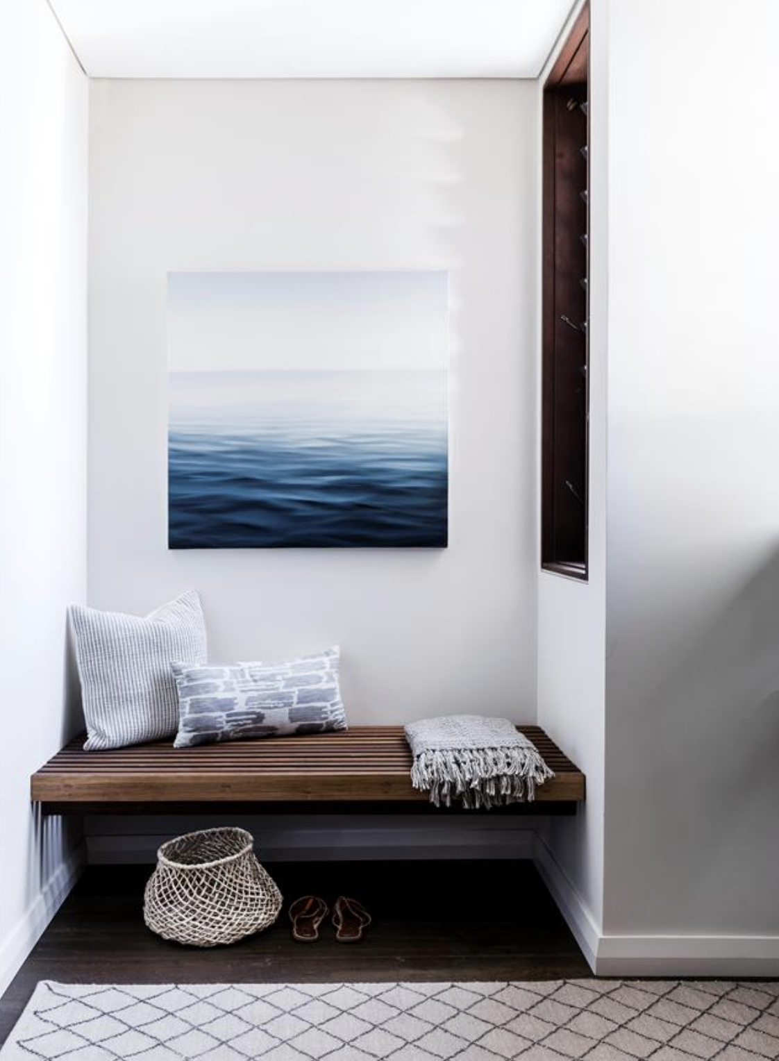The muted blues of this coastal artwork help to bring a sense of calm throughout this room. Showcased by www.homestolove.com.au
