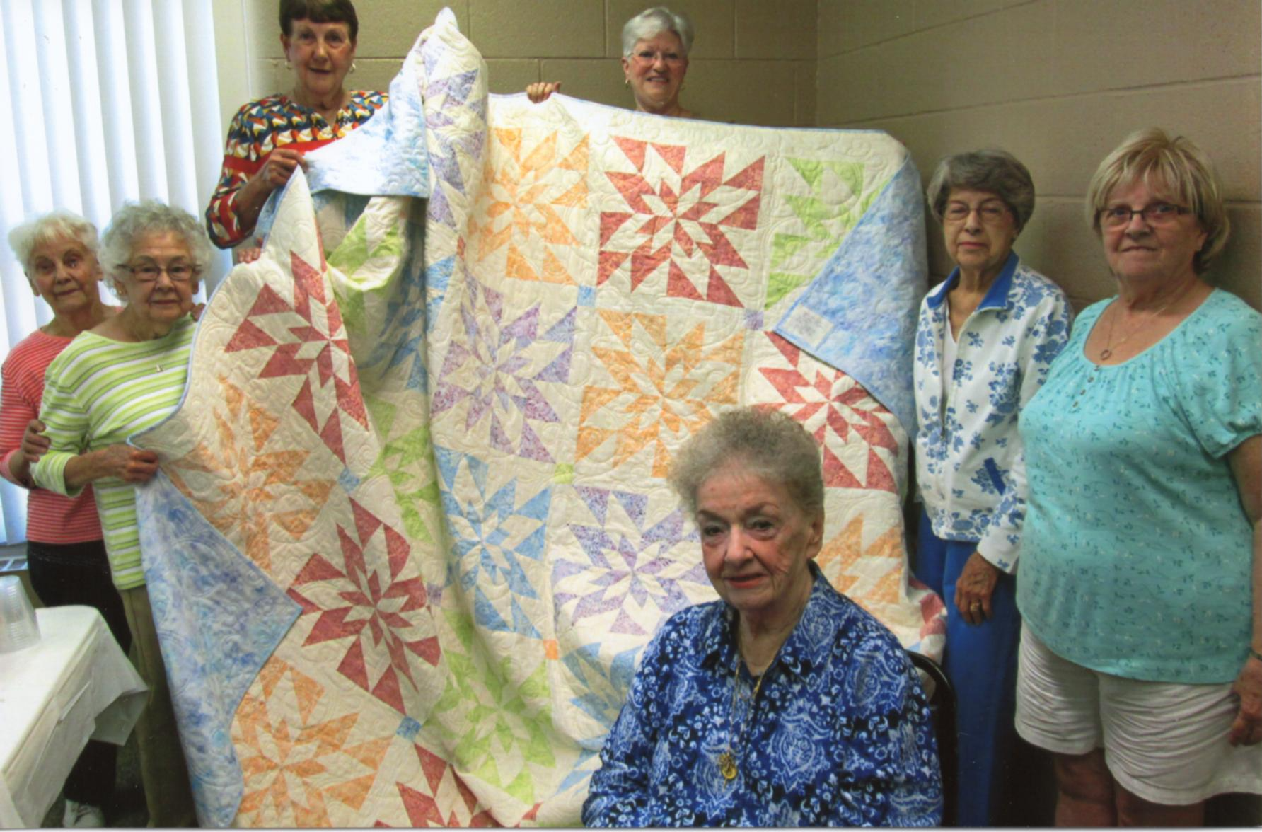 Clockwise from top left: Betty P., Carol N., May R., Audrey M., Rita P., Helen C., and Betty L.