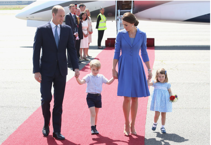 The Duke and Duchess of Cambridge (wearing a Catherine Walker look) with their children, Prince George and Princess Charlotte, on Wednesday as they arrived at Berlin Tegel Airport.CreditChris Jackson/Getty Images