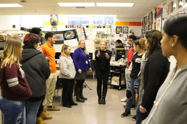 Photo:  wrkxfmly  Photo Facilitator Joanne Miller works with students at Elkton High School in Lanham, Maryland