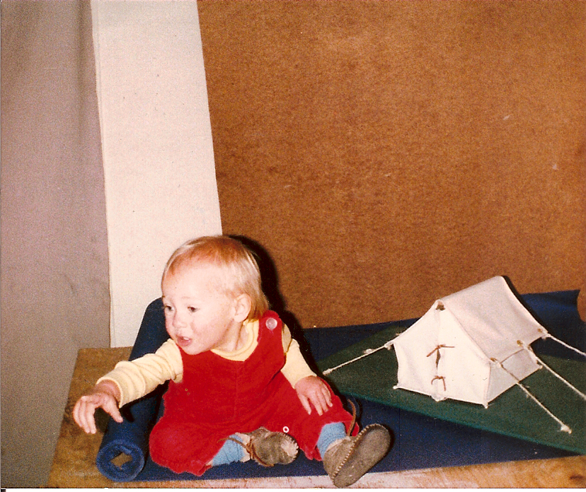 Tiny me in my dad's shop circa 1982, with a model tent.