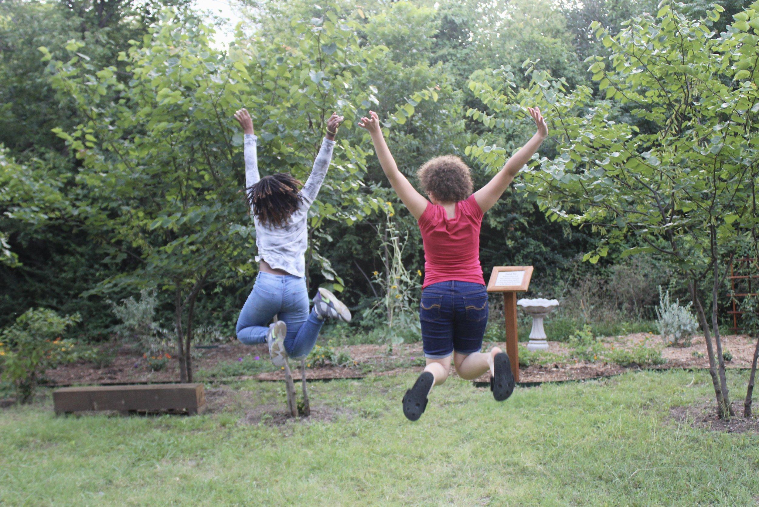 Wheeler House Kids Jumping in Butterfly Garden