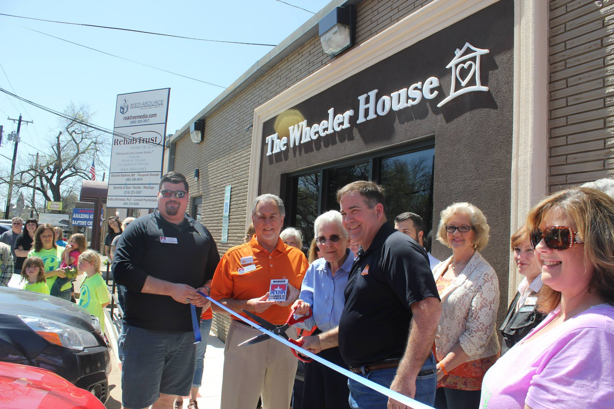 Pat Smith and former Denton Mayor Elinor Hughes cut the ribbon for the grand opening of The Wheeler House in 2015.