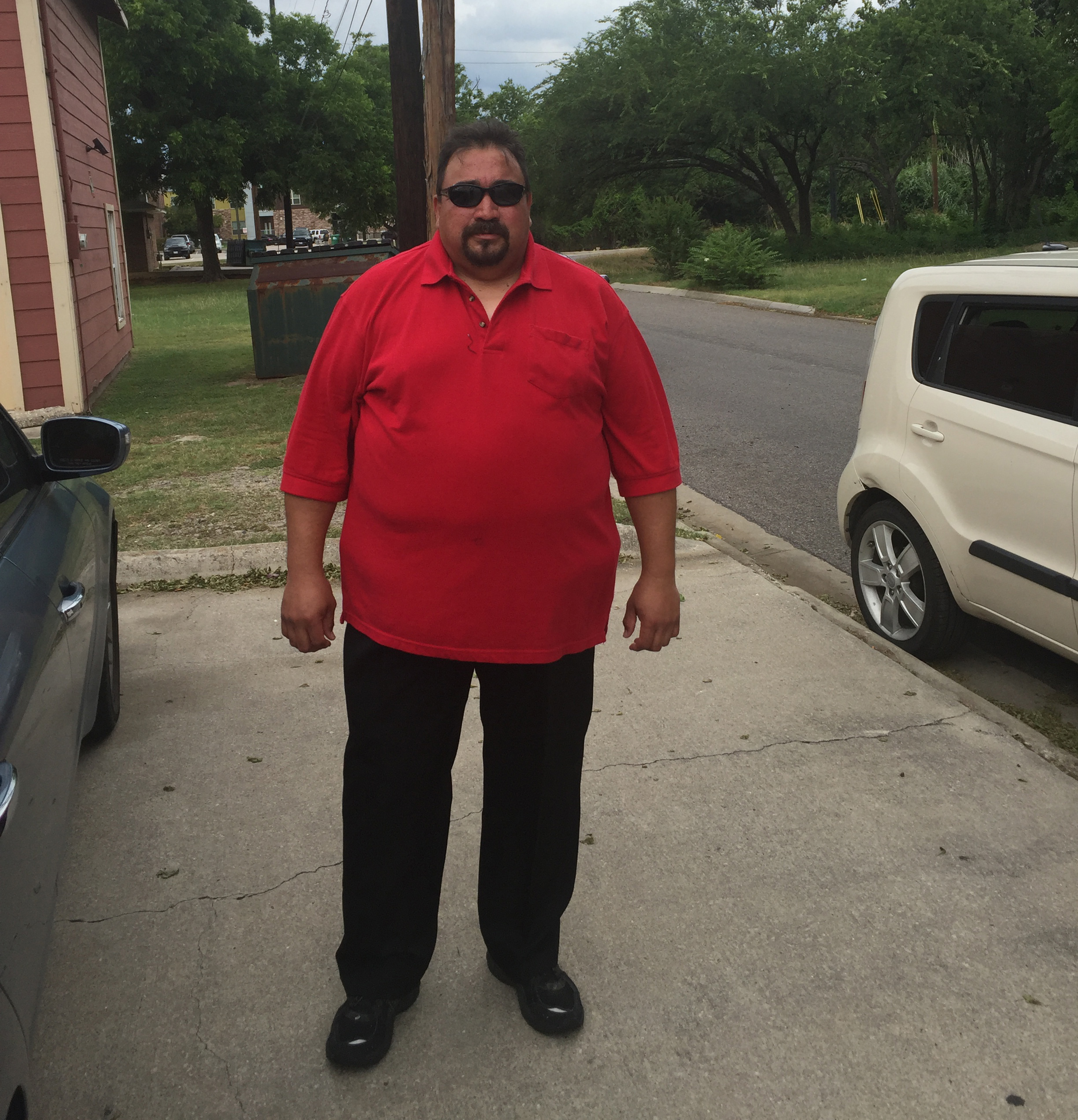 Joe at Vision Ministries in his new clothes for his first day of work.