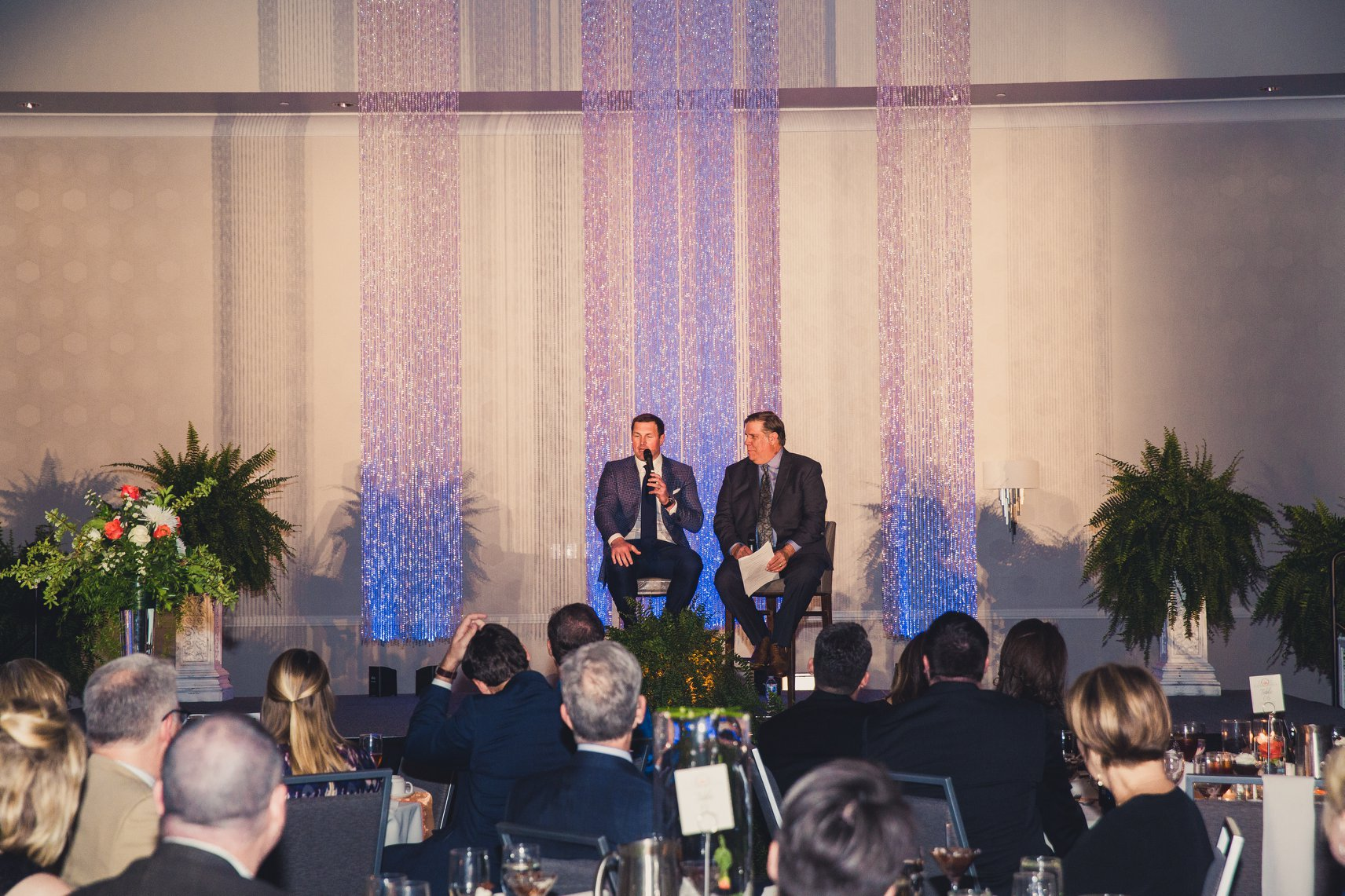 George Dunham  interviews  Dallas Cowboys  tight-end  Jason Witten  at Serve Denton's sixth annual Celebration hosted at Embassy Suites.