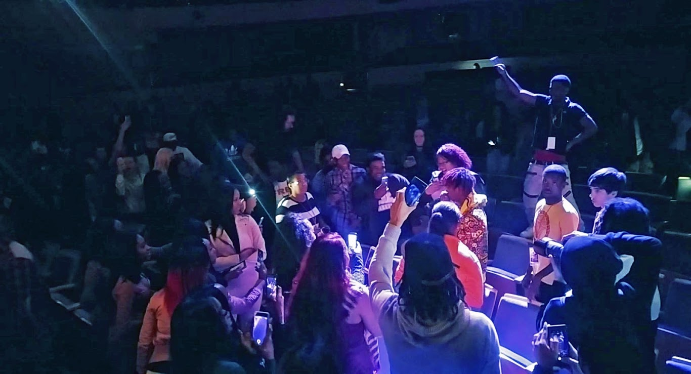 Famous Dex wanders the audience in a mostly empty Overture Hall. Photo by Michael Penn II.