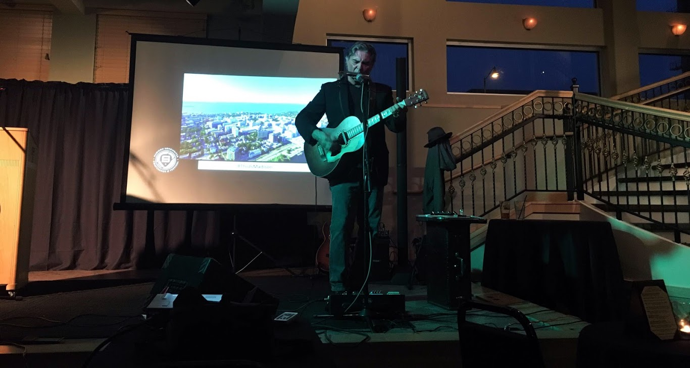 Madison singer-songwriter Robert J performed at Tuesday's event at the Brink. We're not sure if he brought his own PA.
