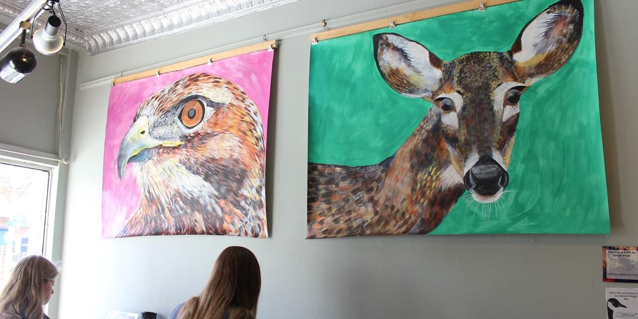 "Natalie Wright's ""Hawk"" and ""Deer Painting,"" currently on display at Johnson Public House. Photo by Sarah Witman."