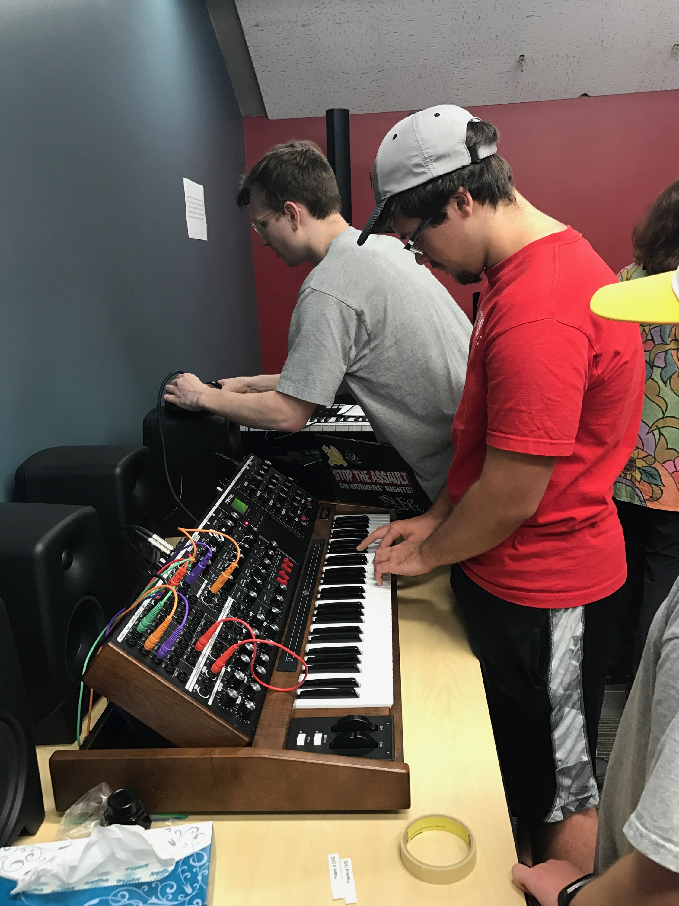 Visitors at EARS' September open house playing the space's new Minimoog synthesizer. Photo by Emili Earhart.