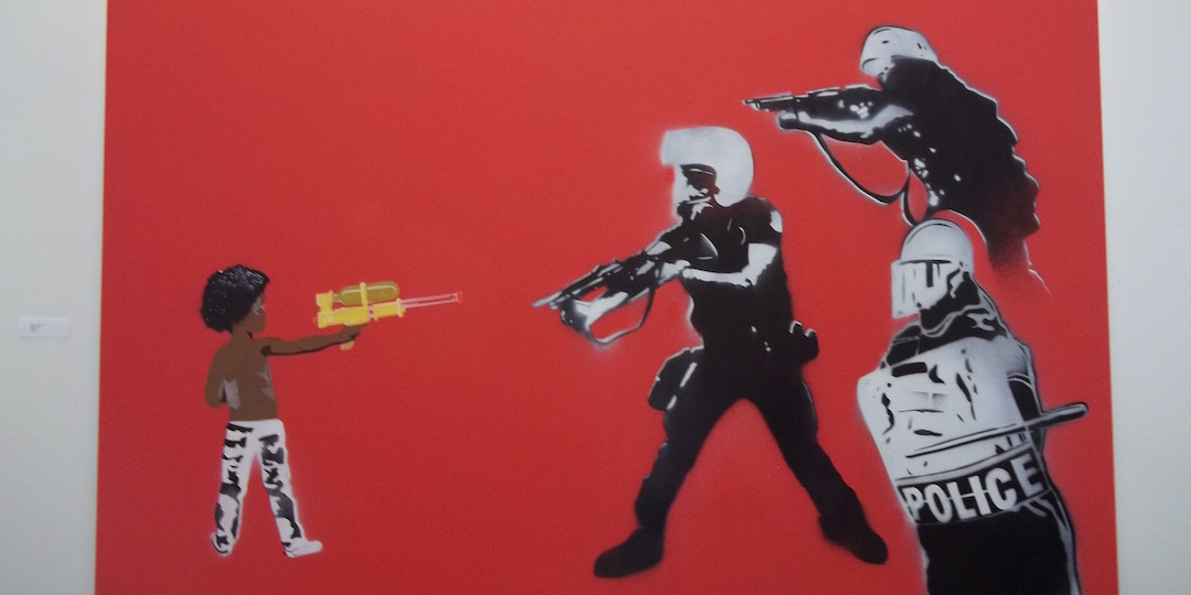 """Mike Lroy's """"Don't Shoot,"""" on display at the Central Library."""