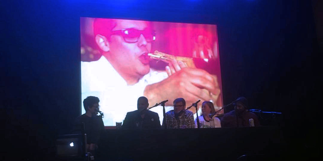 Our panel, dwarfed by an image of Andre Darlington indulging in  bone luge . Photo by Daniella Echeverria.
