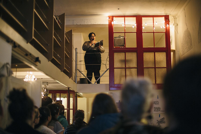 UW-Madison professor Dr. Sami Schalk reading at Everyday Gay Holiday in February 2017. Photo by Jennifer Bastian.