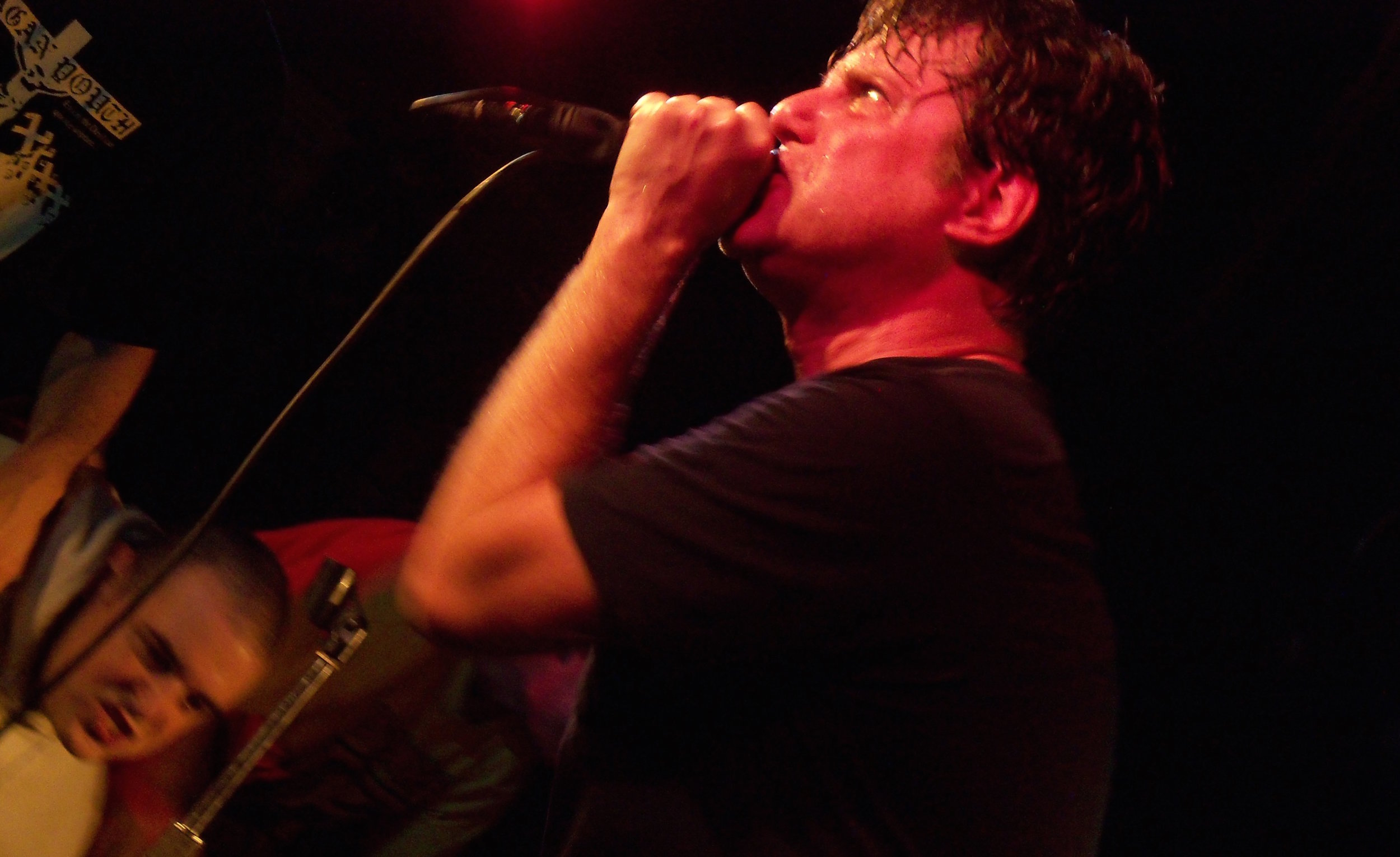 Negative Approach's John Brannon performing in 2009. Photo via  T he All-Nite Images on Flickr.
