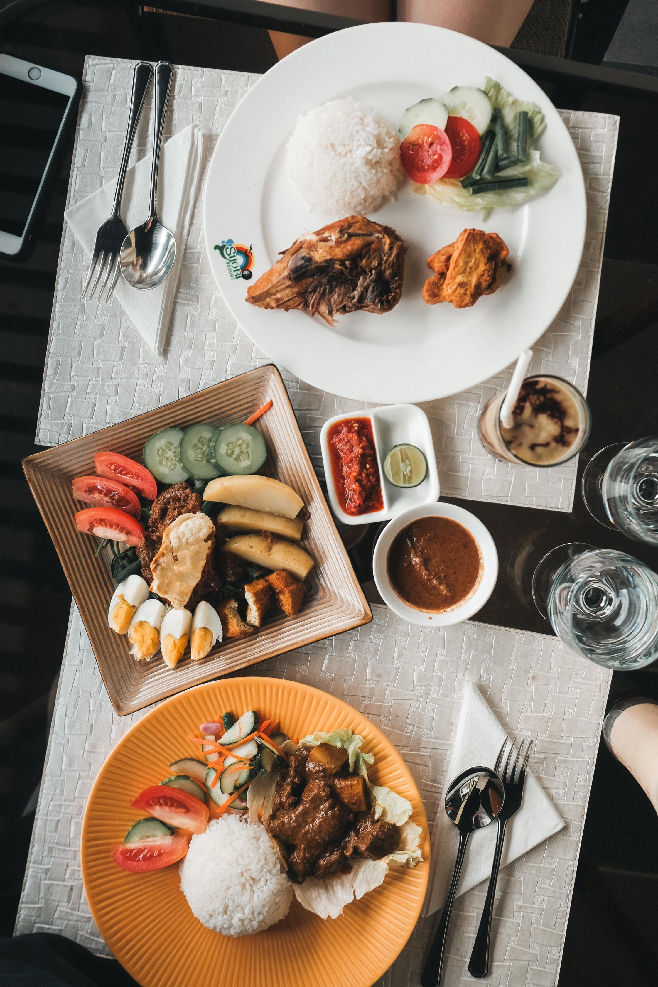 From top to bottom: Ayam Penyet, Avocado Juice (Alpukat), Gado Gado, Beef Rendang