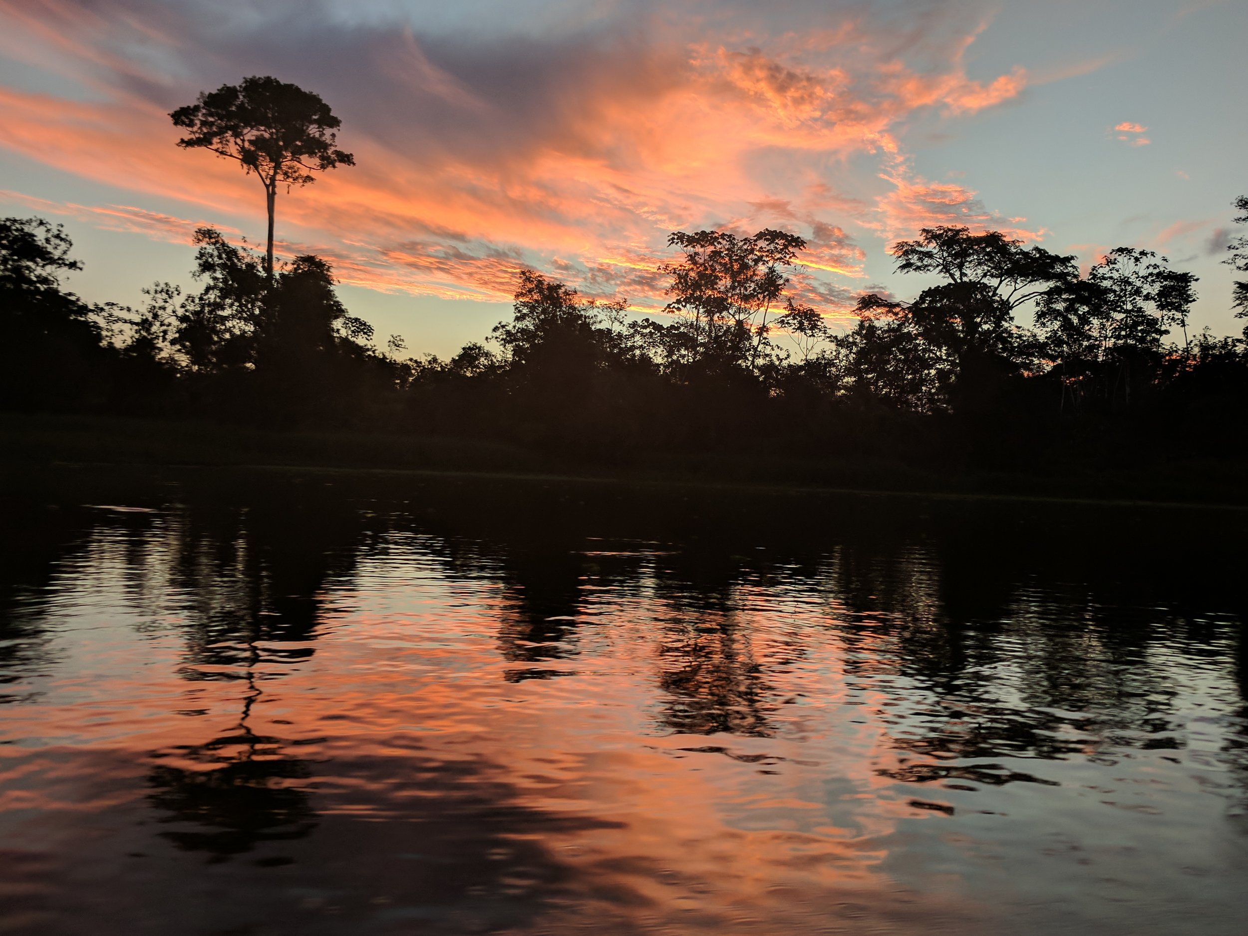 Sunset over the canal leading to our Amazon lodge
