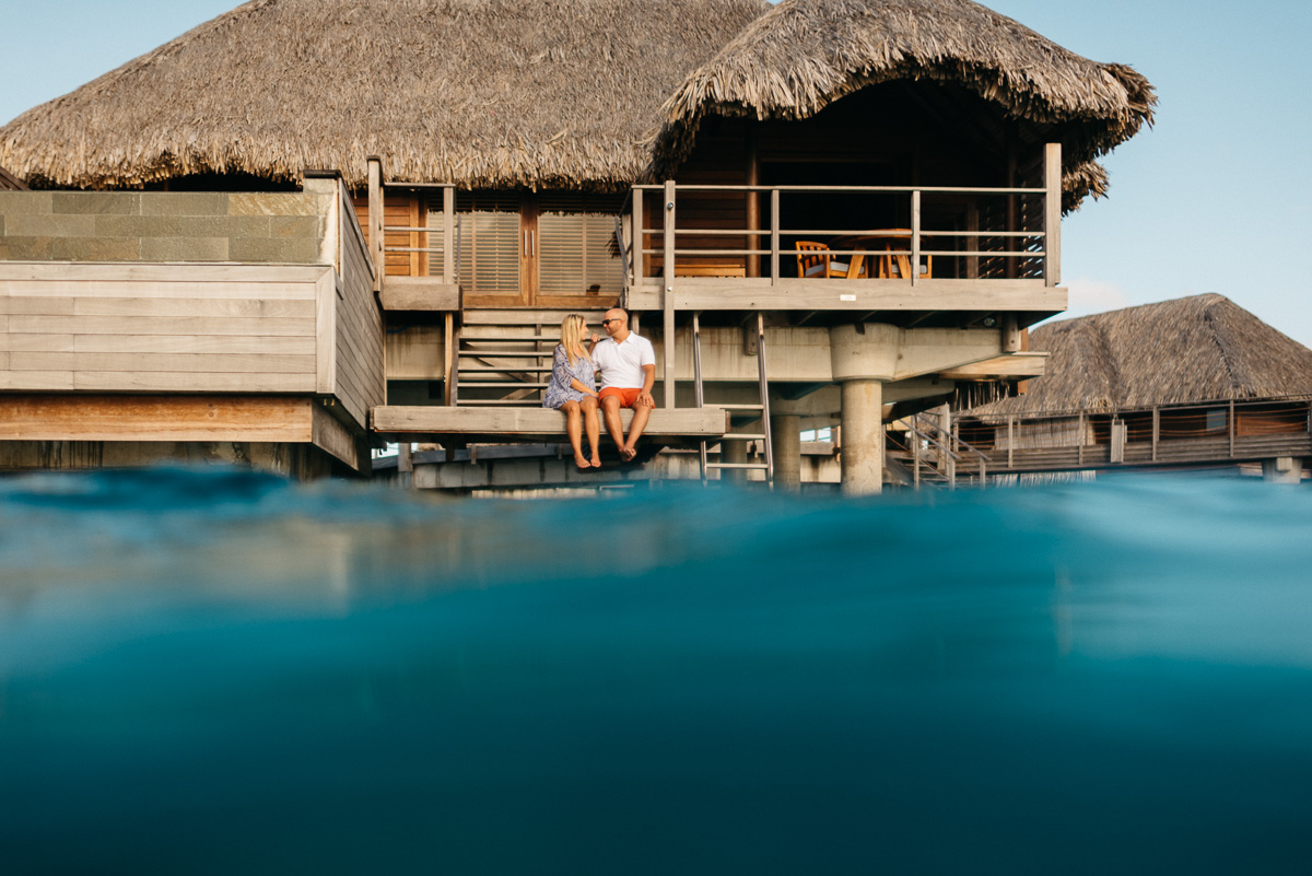 Destination Honeymoon photography in the overwater bungalows at the Four Seasons resort in Bora Bora
