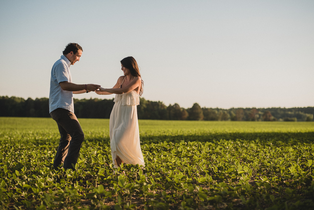 Mississippi engagement photography outside dancing in a field