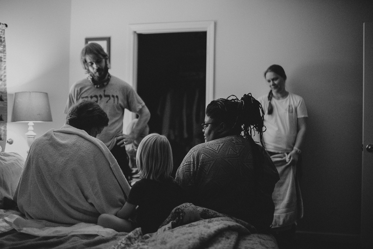 home birth photography with midwife and family