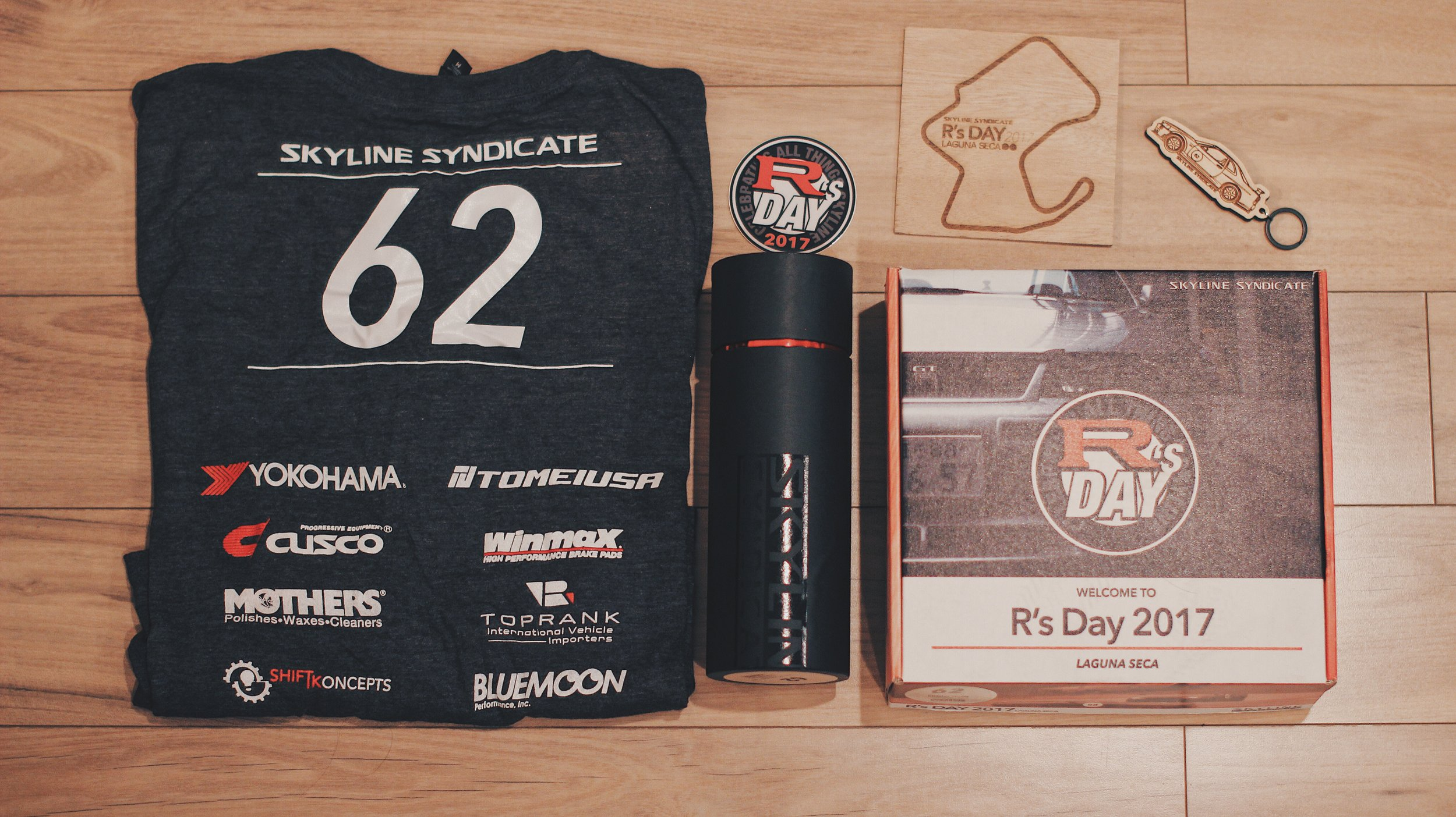 And here is my premium package from Skyline Syndicated featuring a T-shirt with my track car number, a keychain and a Laguna Seca Map.
