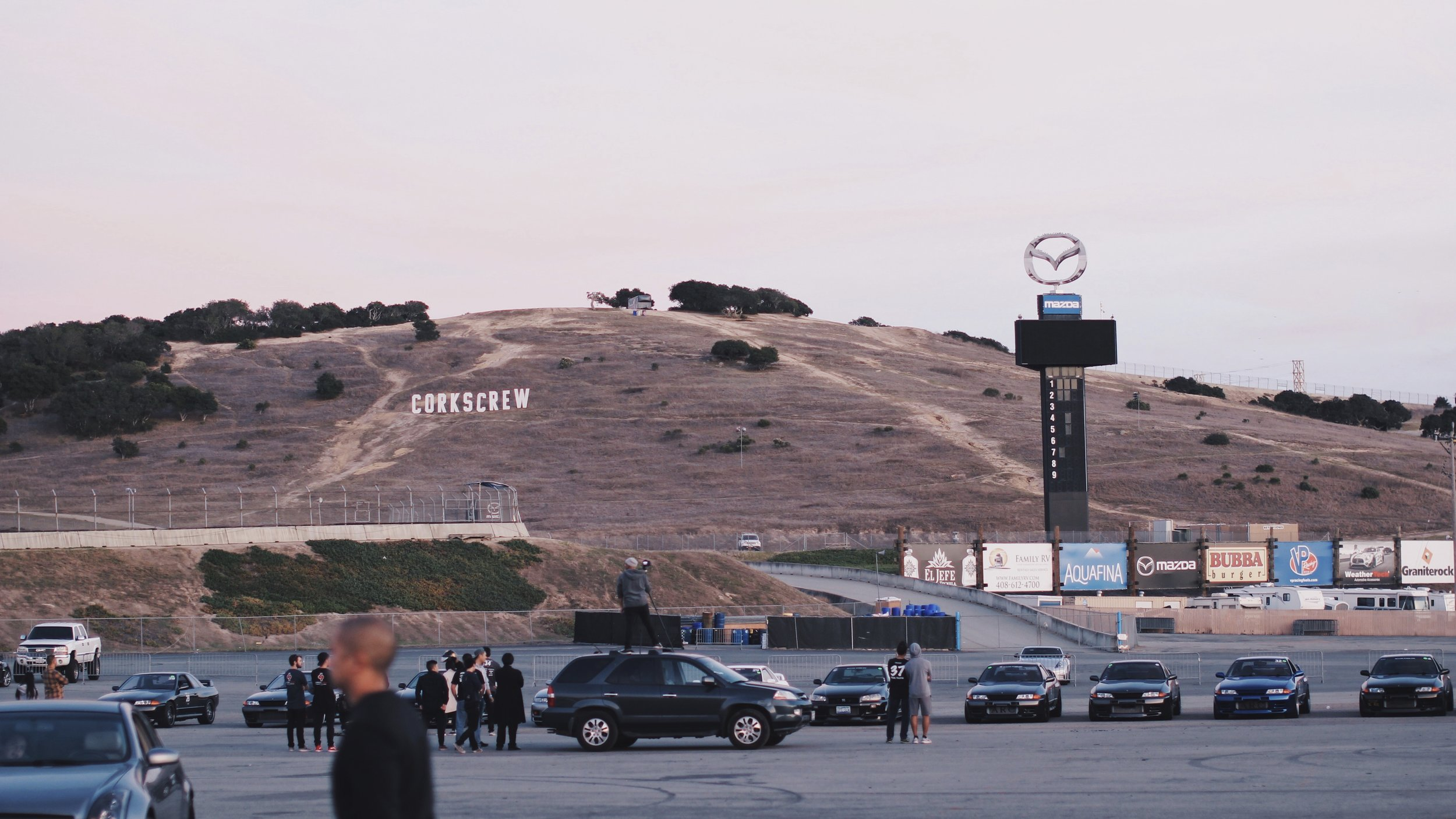I couldn't sleep the whole night since I have been very anxious about the event. We all woke up at 7 am to quickly get ready for the big day. As I was rolling into Laguna Seca, I had a moment feeling that I have been here before. Of course,I knew it was my first time, but it was a powerful experience of déjà vu from my GrandTurismo gaming days since the PS1 era. Being at Laguna Seca in person was a remarkable and unforgettable experience. The track is very spacious and I've seen nothing like this back home. And here is a pit garage I rented for my car and equipments.