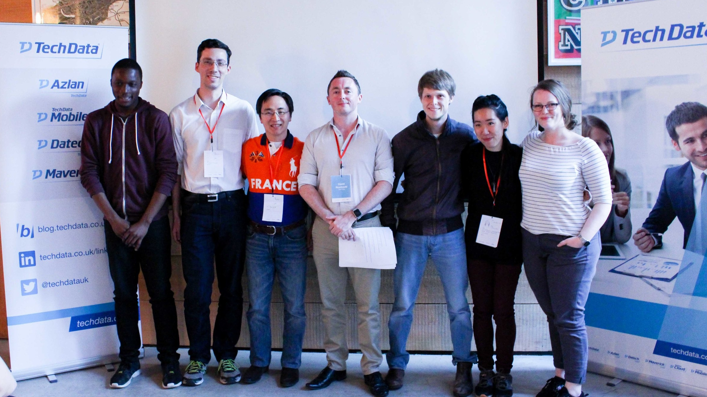 Tech Data Hack winners Hivefy:Adrien, Enyinna, and Kaho.Runners-up Re-draft: Sophie, Joshua, and Cih-Han . Judge David Newbould, from Tech Data Cloud.