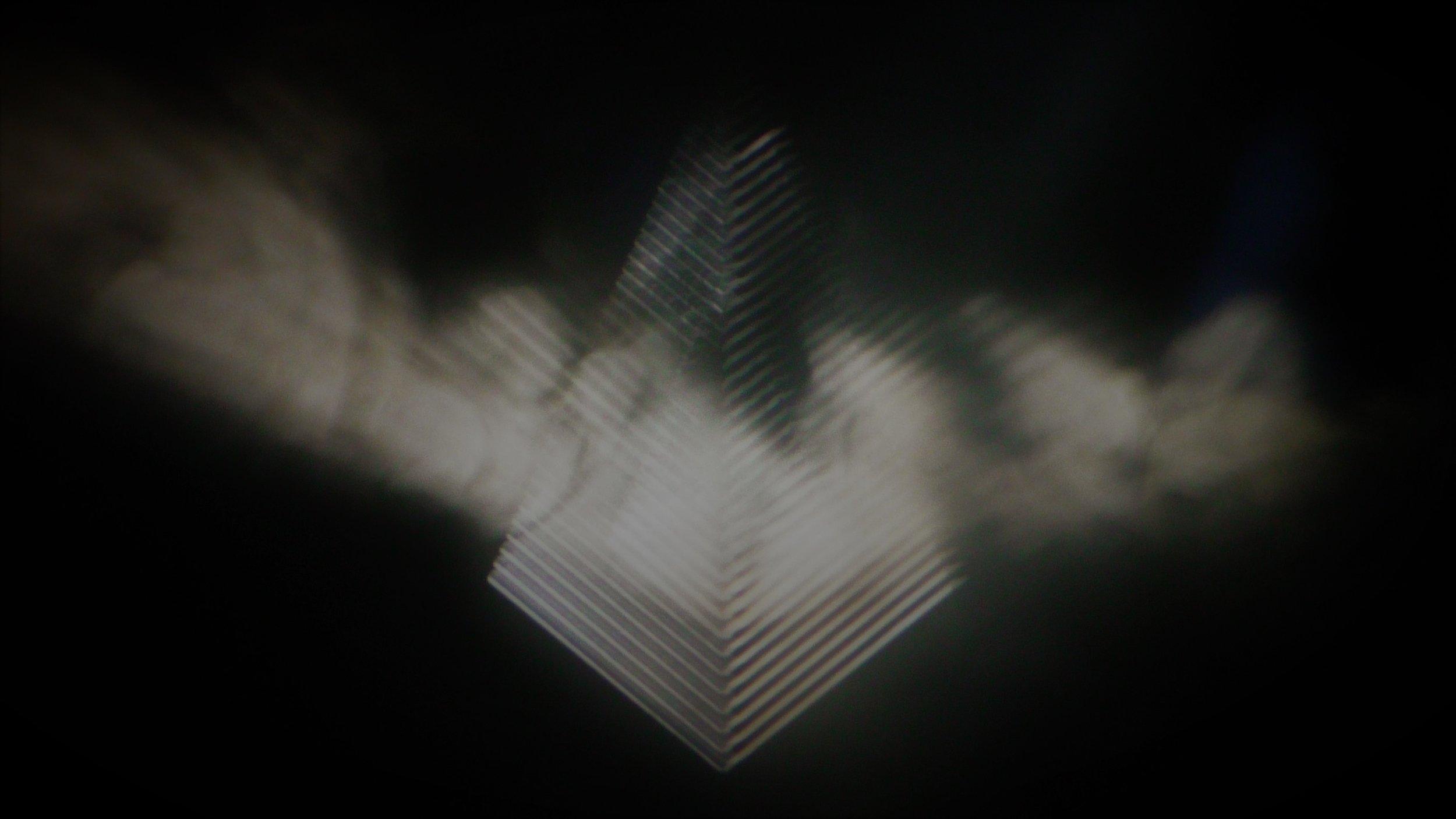 pic 003 - Kiasmos Projection Symbol.jpg