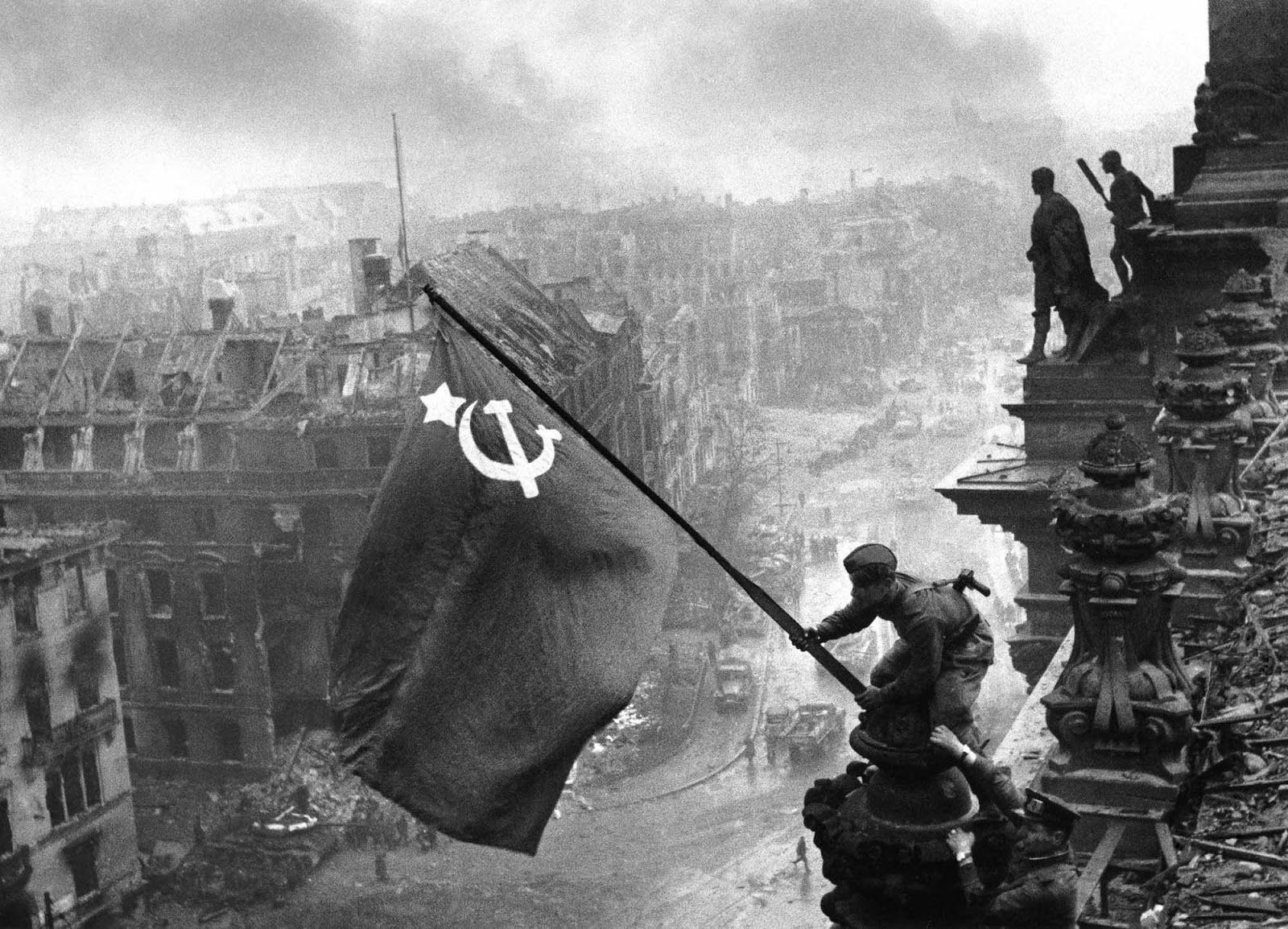 The famed raising of the Hammer and Sickle over the fallen  Reichstag  was, like the one with the Marines raising flag over Iwo Jima, staged for the paps after the tumult of battle had ceased.