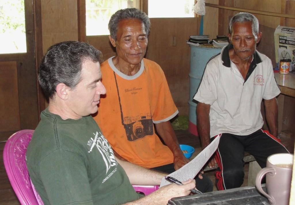 Bob Clark with Tugutil men