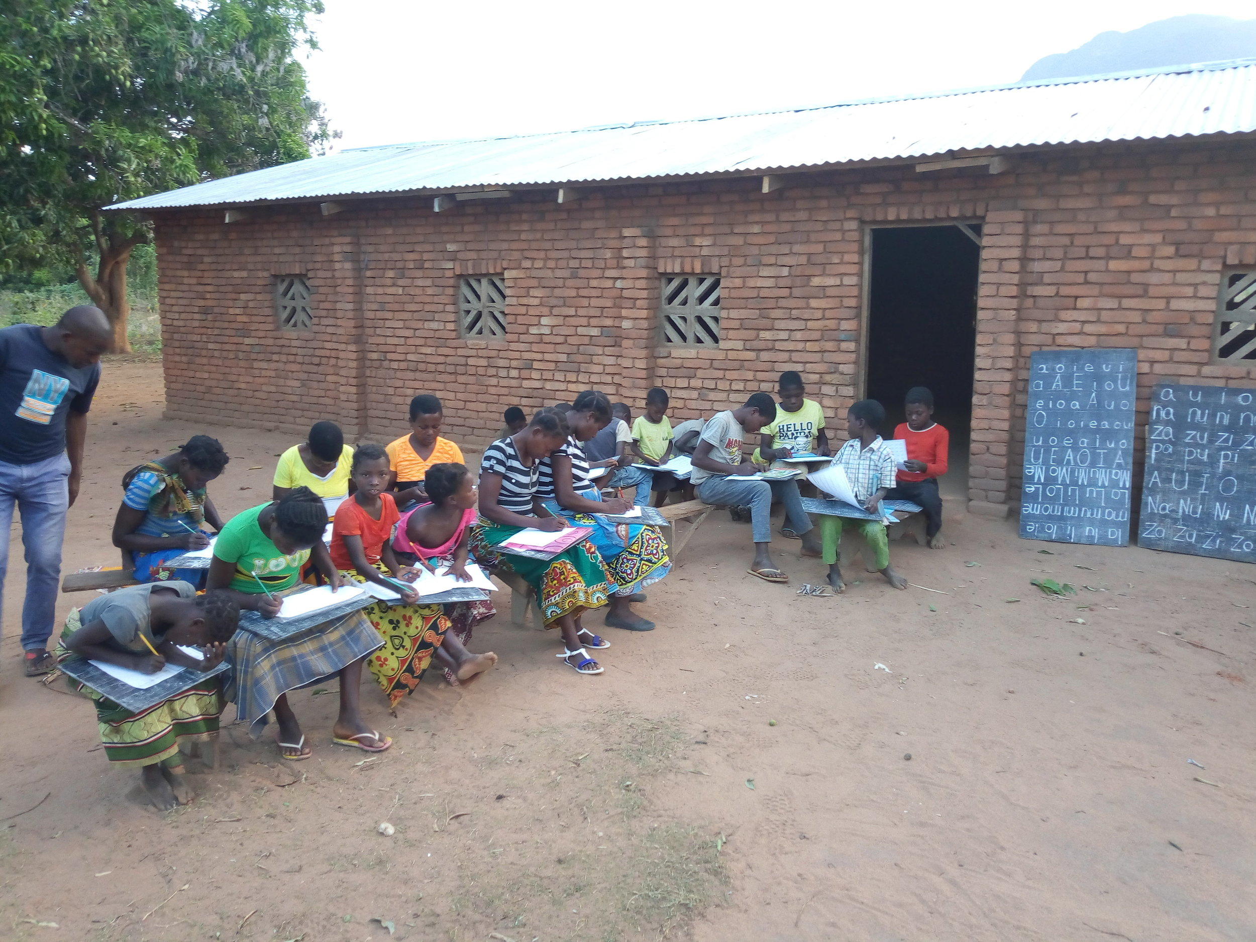 Yolo youths having an outdoor literacy lesson