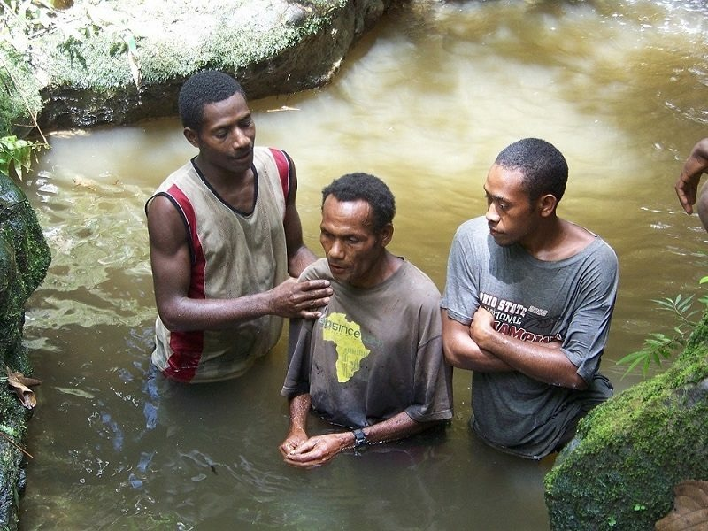 Topa Tamana being baptised.