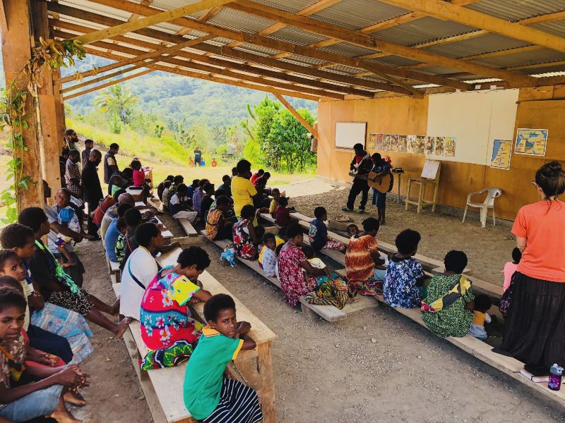 Menyan people gather to praise God and hear teaching from the Bible