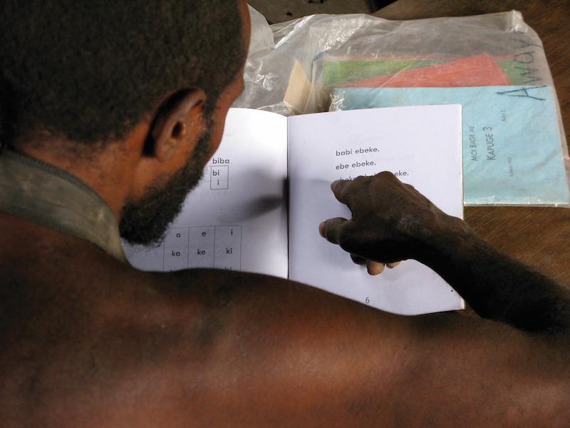 Moi man practicing reading