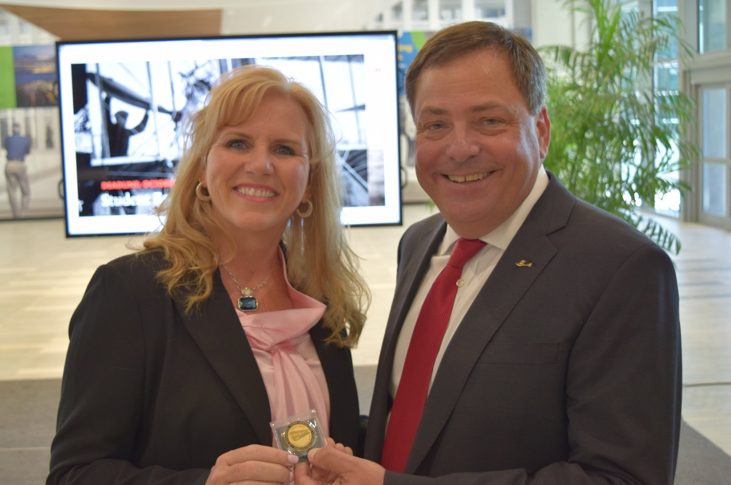 Paul Piro presenting Tony Jannus Centennial Coin to Jeannie Driscoll after Press Conference, 9 May '17.JPG