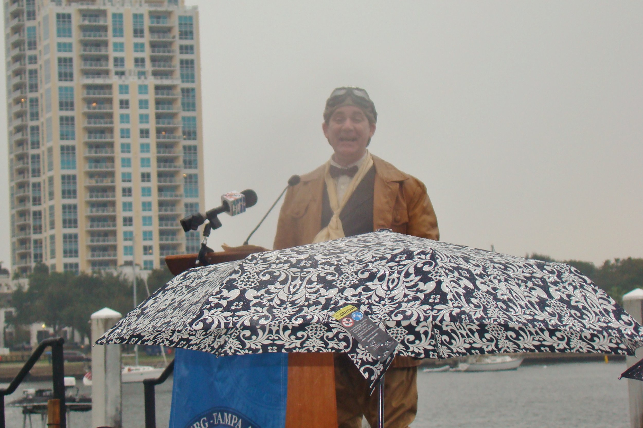 Tony Jannus - a. k. a., Michael Norton - addressing crowd in rain, 1 Jan '14.JPG