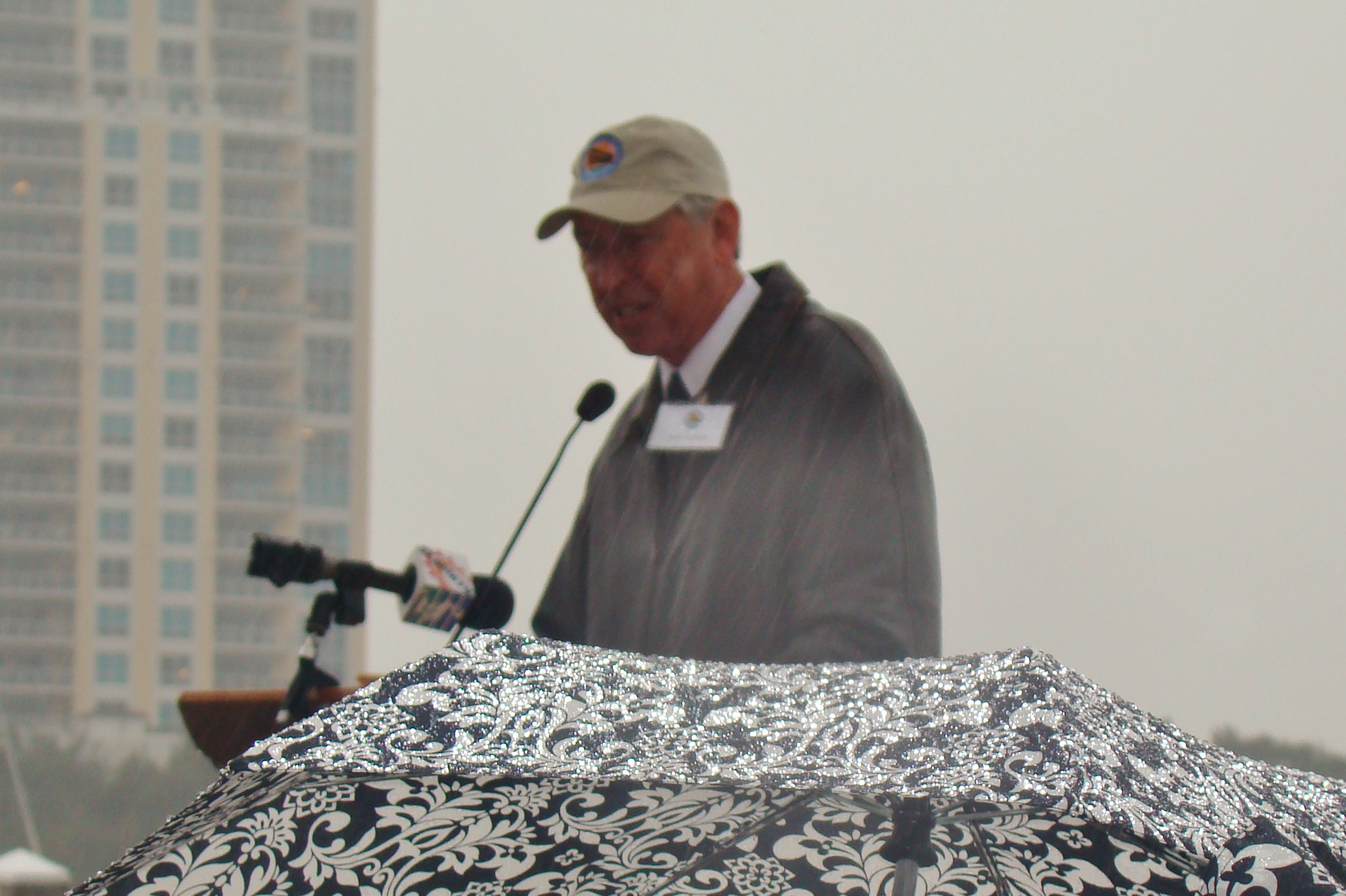 Will Michaels addressing crowd in rain, 1 Jan '14.JPG
